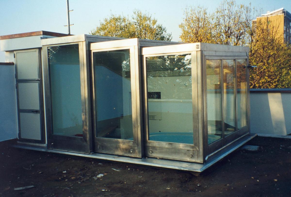 Veranda retrattile in acciaio inox e vetro